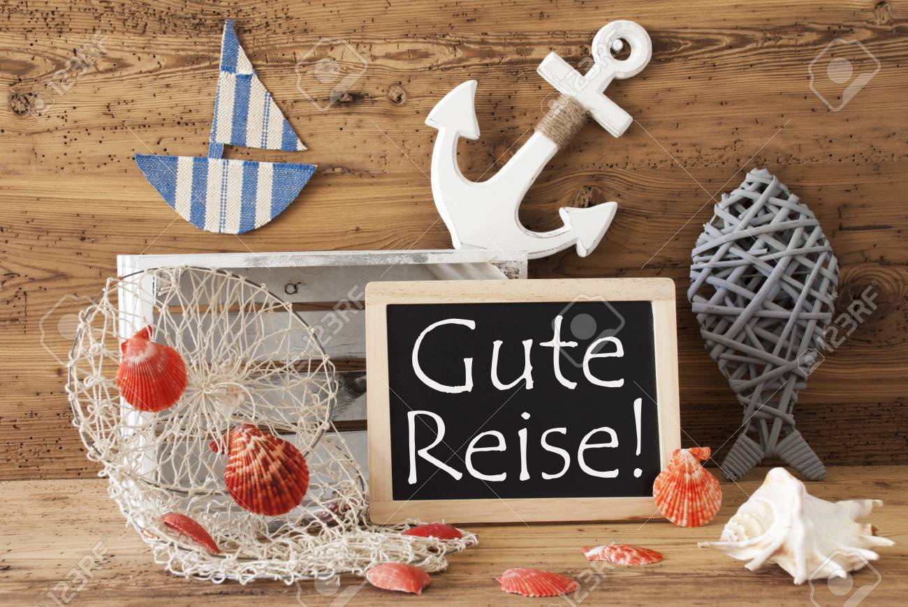 Blackboard with nautical summer decoration and wooden background blackboard with nautical summer decoration and wooden background german text gute reise means good trip kristyandbryce Gallery