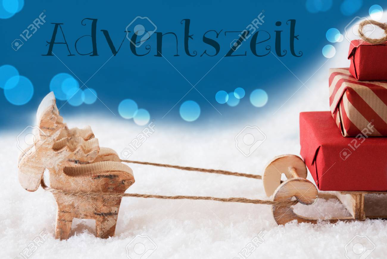 Moose is drawing a sled with red gifts or presents in snow german text adventszeit means advent season moose is drawing a sled with red gifts or presents in snow christmas card for m4hsunfo