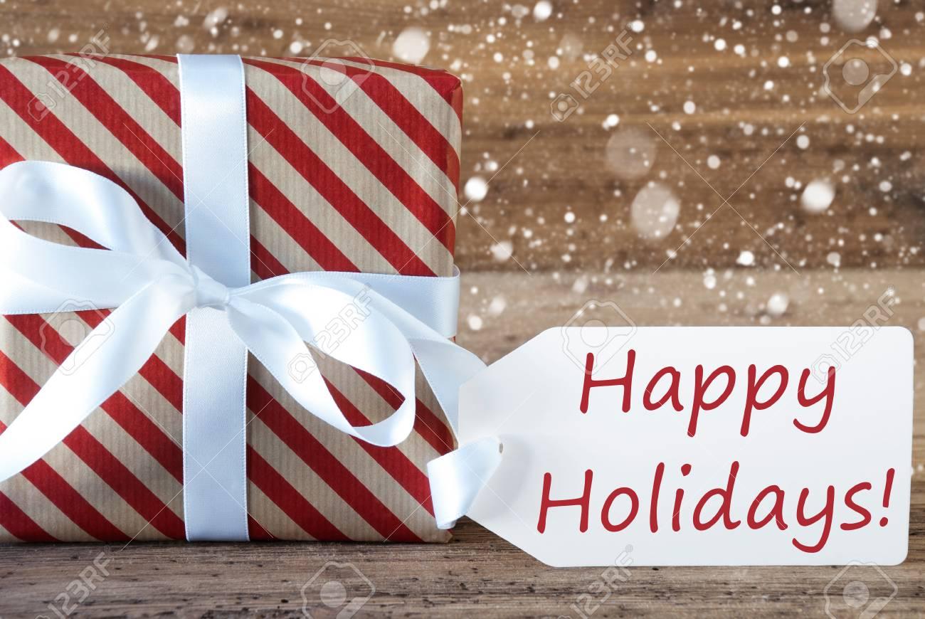 weihnachten geschenk oder ein geschenk auf holz-hintergrund mit