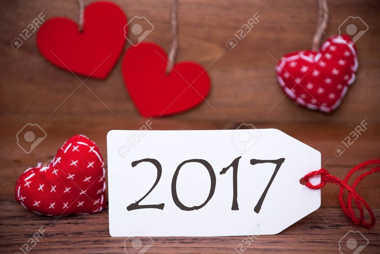 label with english text 2017 for happy new year greetings white label with red textile