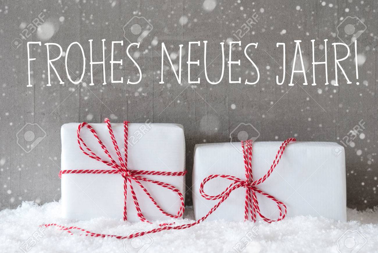 german text frohes neues jahr means happy new year two white christmas gifts or presents