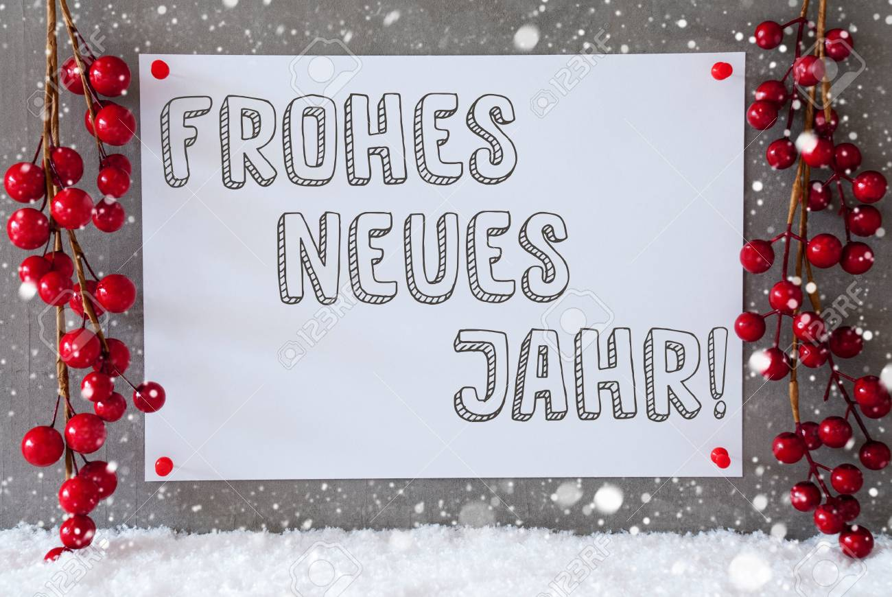 label with german text frohes neues jahr means happy new year red christmas decoration on