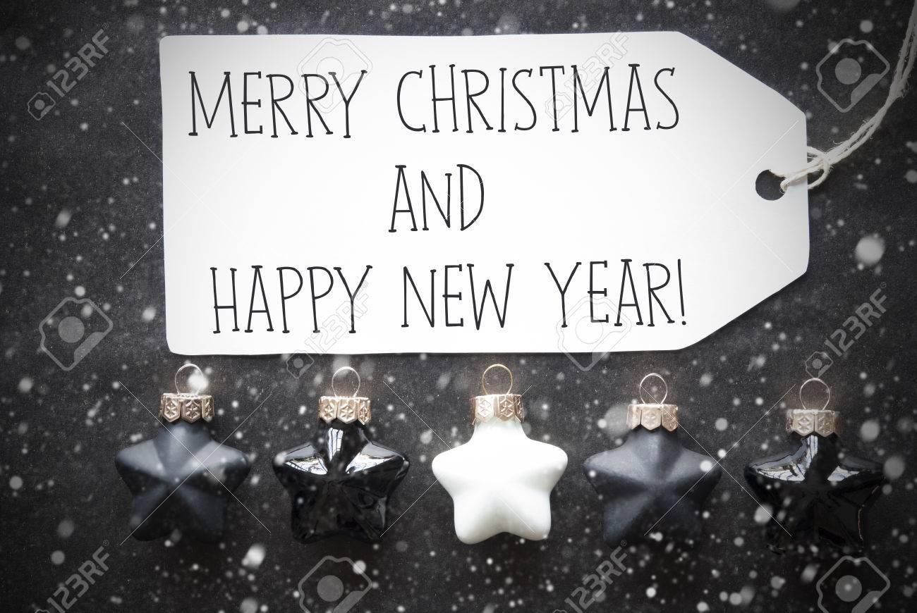 Label With English Text Joyeux Noël Et Bonne Année Boules De Sapin De Noël Noir Et Blanc Sur Fond De Papier Noir Avec Des Flocons De Neige