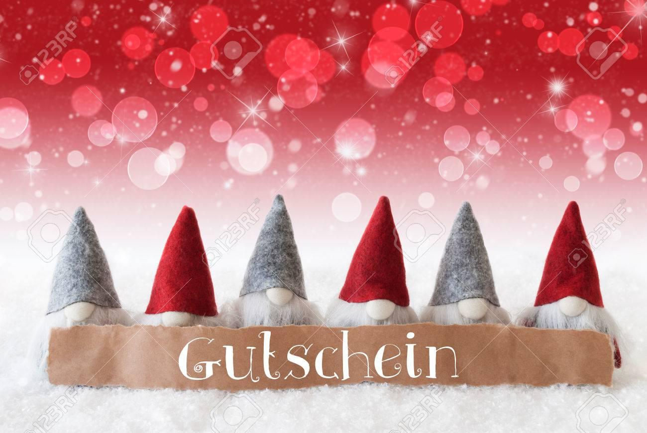 Label with german text gutschein means voucher christmas greeting label with german text gutschein means voucher christmas greeting card with red gnomes sparkling m4hsunfo
