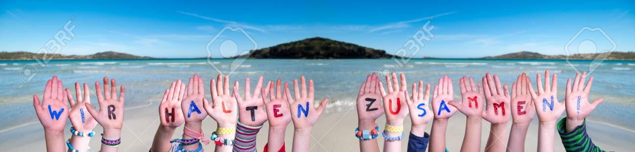 Hands Building Wir Halten Zusammen Means Together We Are Stron, Ocean Background - 144692647