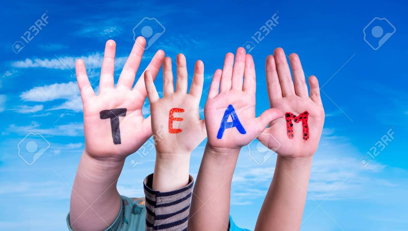 Children Hands Building Word Team, Blue Sky - 147784133