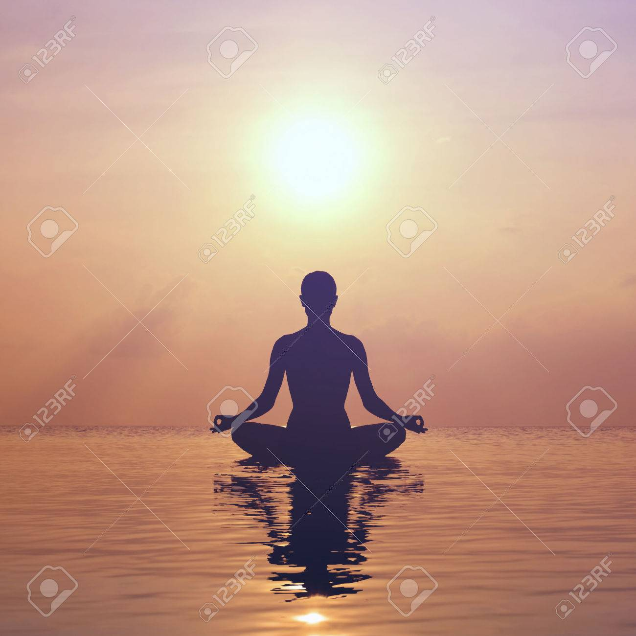Silhouette young woman practicing yoga on the beach at sunset - 34786930