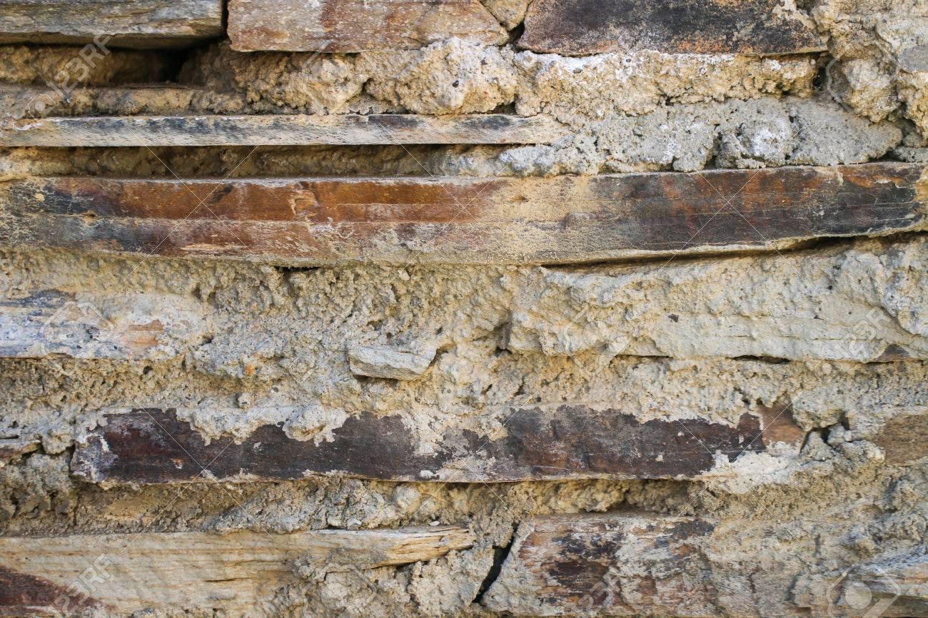 foto de archivo textura de muro de piedra natural para el fondo muro de piedra construido a partir de piedras y rocas de diferentes tamaos