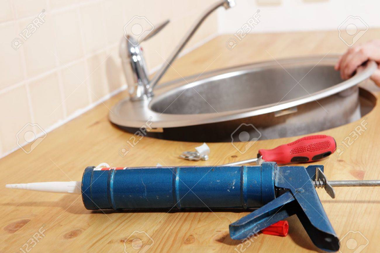 Caulking Gun With Silicone Sealant Against Kitchen Sink Installation  Process Stock Photo   8158474