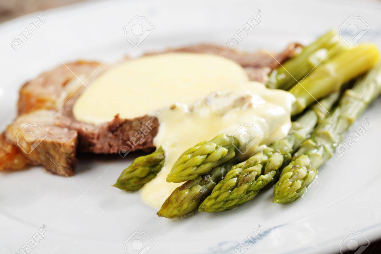 Roast Beef And Asparagus Under Cheese Sauce Stock Photo 8571878