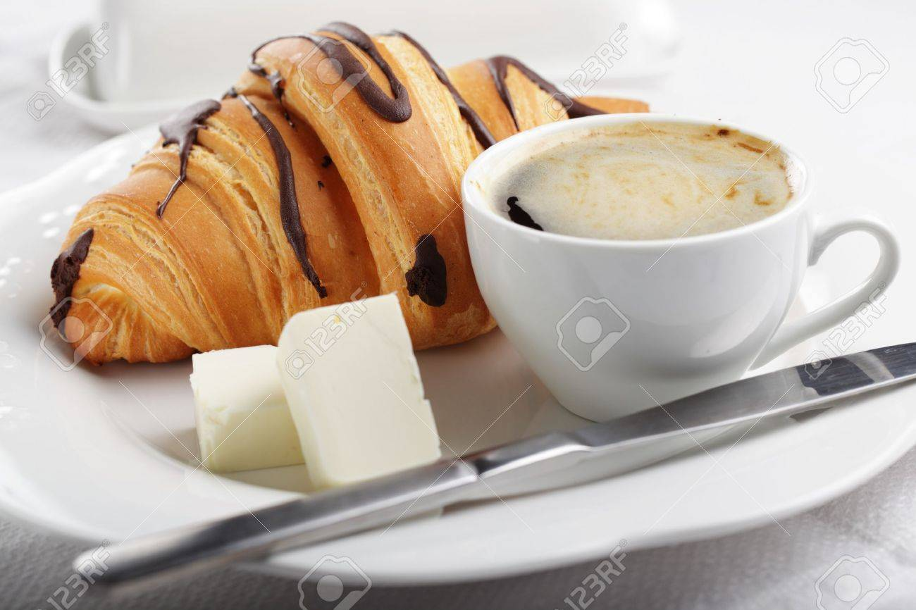 Breakfast with croissant, butter, and coffee Stock Photo - 9494298