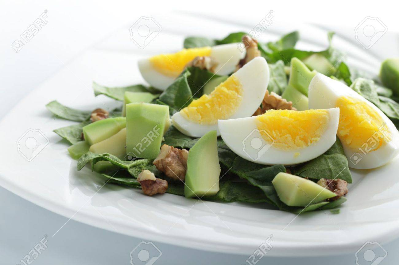 Salad with spinach, avocado, boiled eggs, and walnuts Stock Photo - 9493332