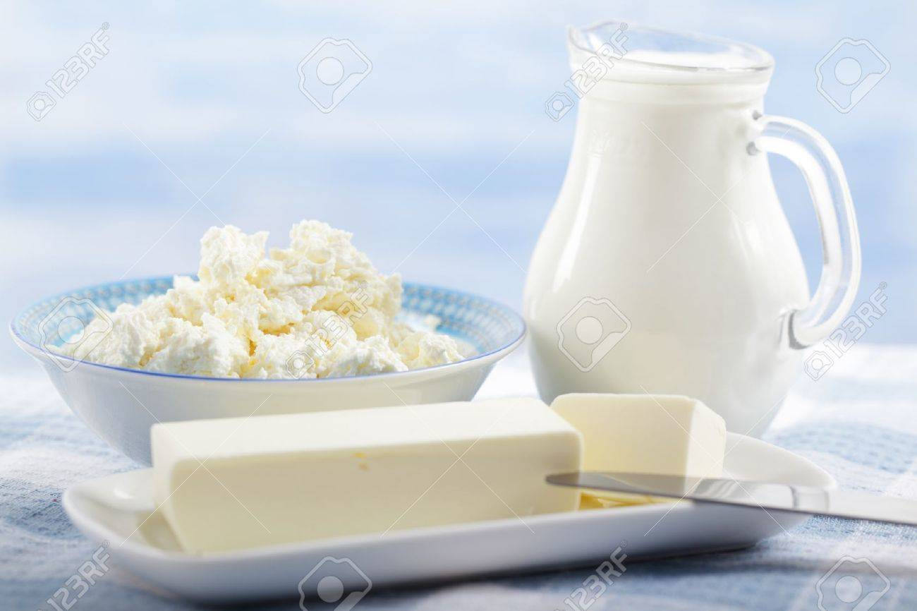 Butter, cottage cheese, and the jug of milk on the table Stock Photo - 9647794