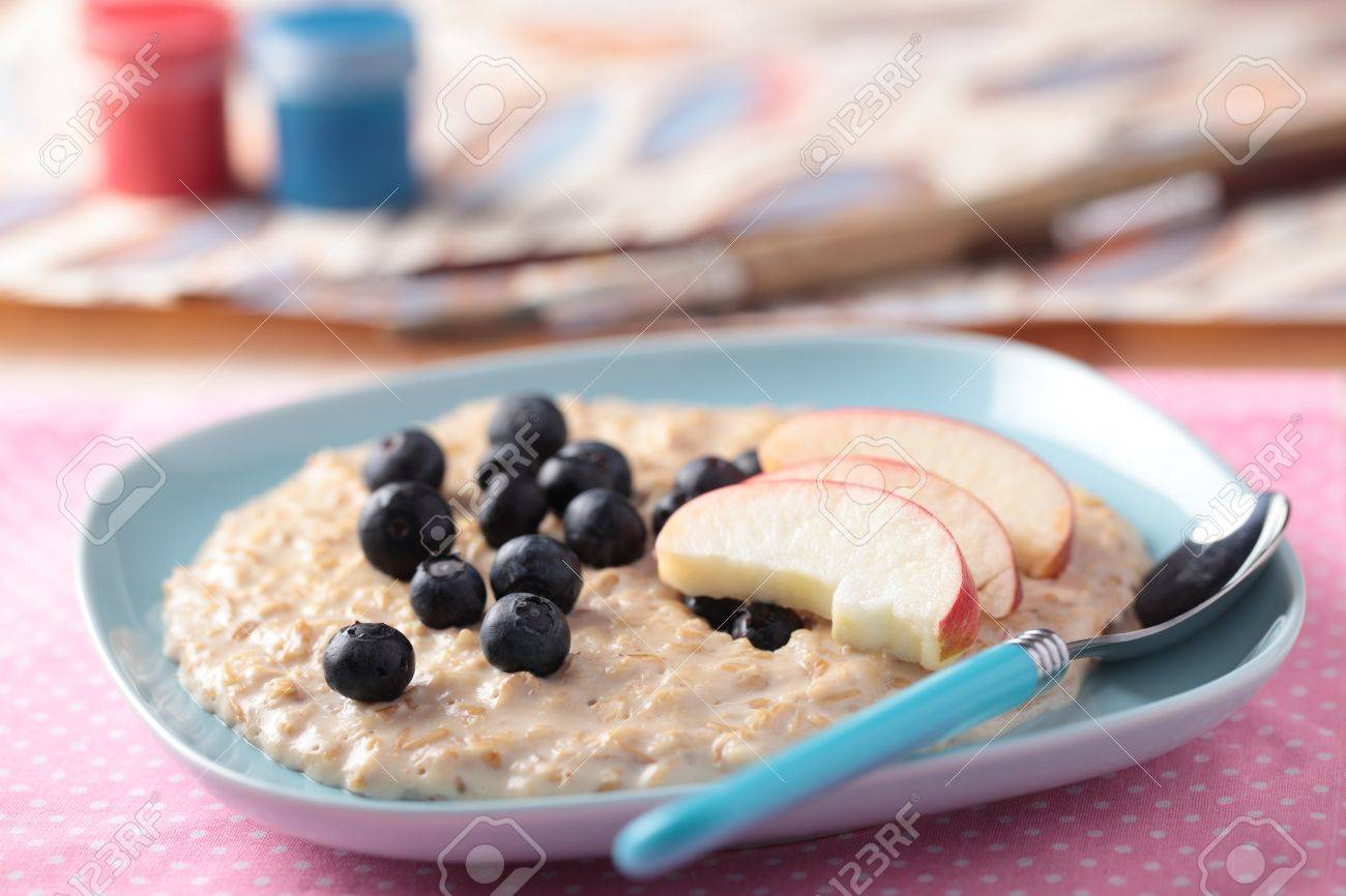 Kids breakfast with oatmeal porridge and fruits Stock Photo - 11771343