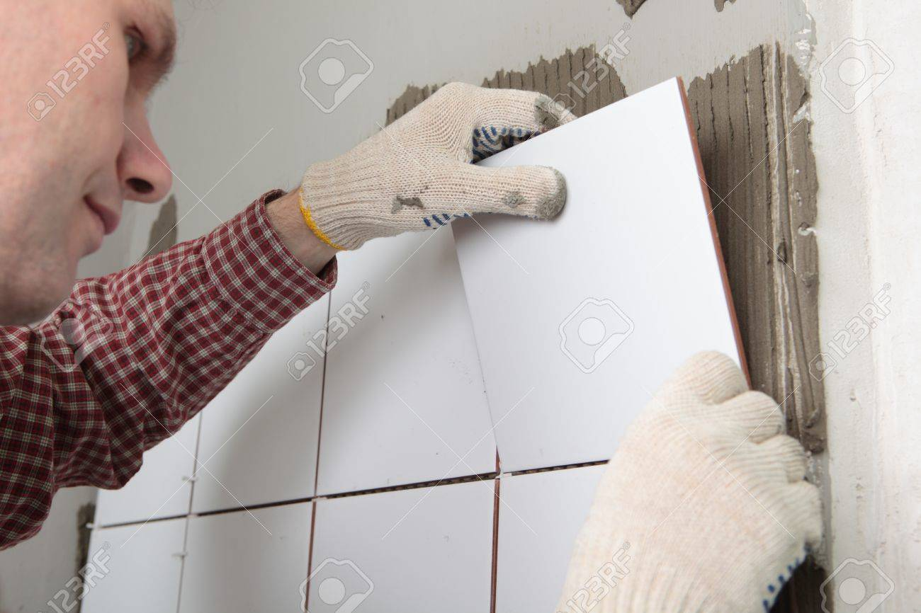 Contractor installing tiles on a wall Stock Photo - 13033521