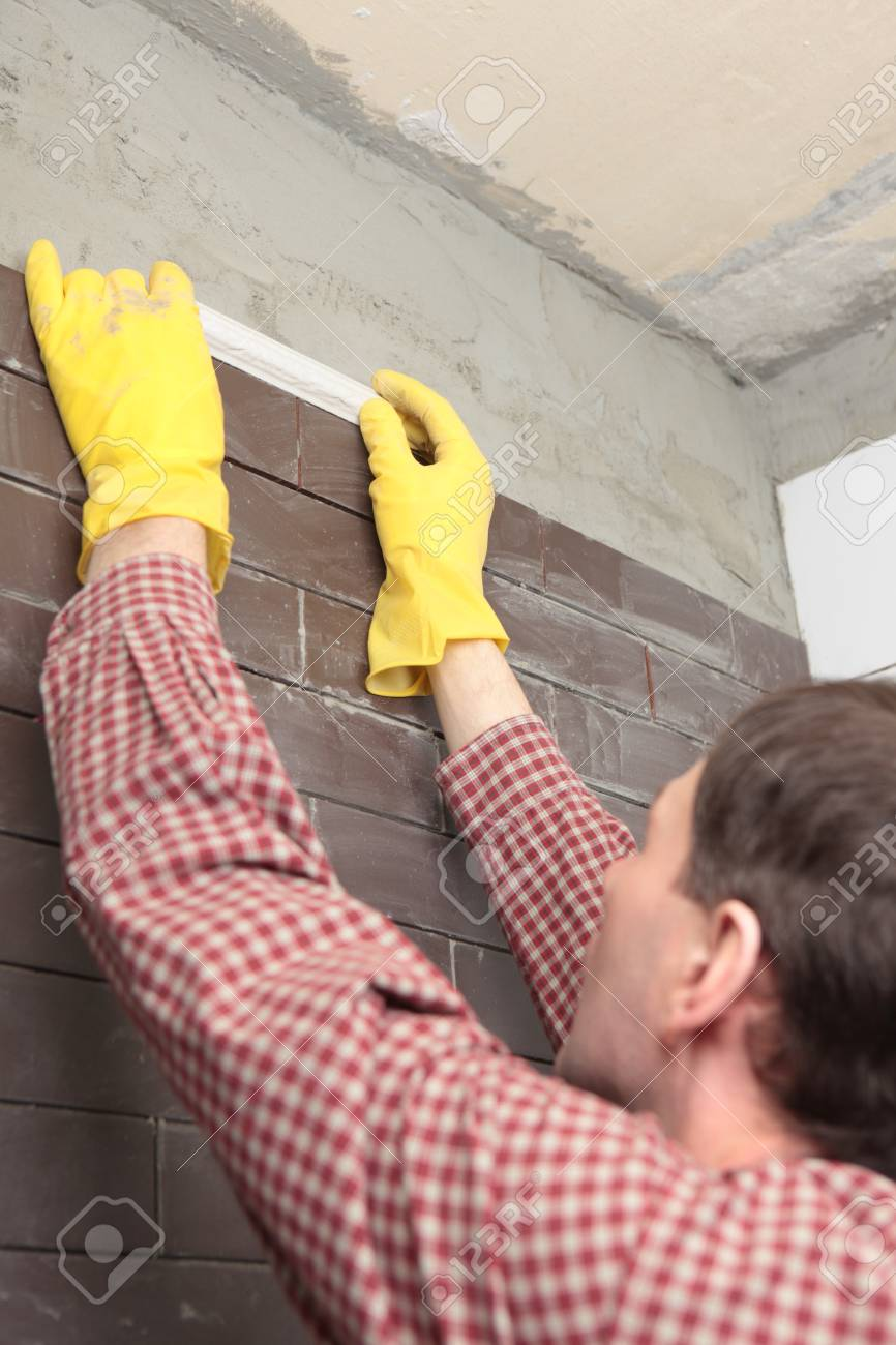 Contractor installing tiles on a wall Stock Photo - 13761953