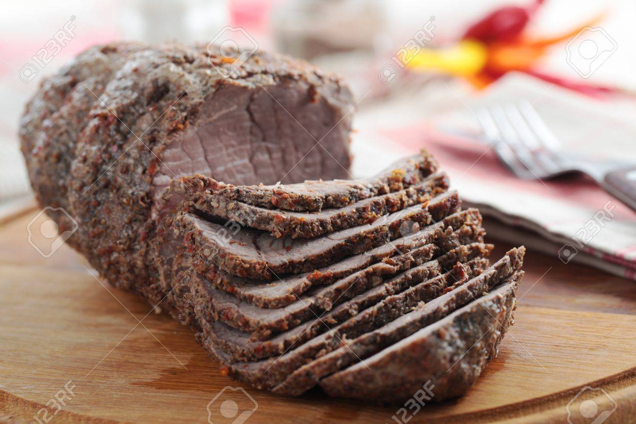 Sliced roast beef package - Sliced Roast Beef On A Wooden Cutting Board Stock Photo 16133607