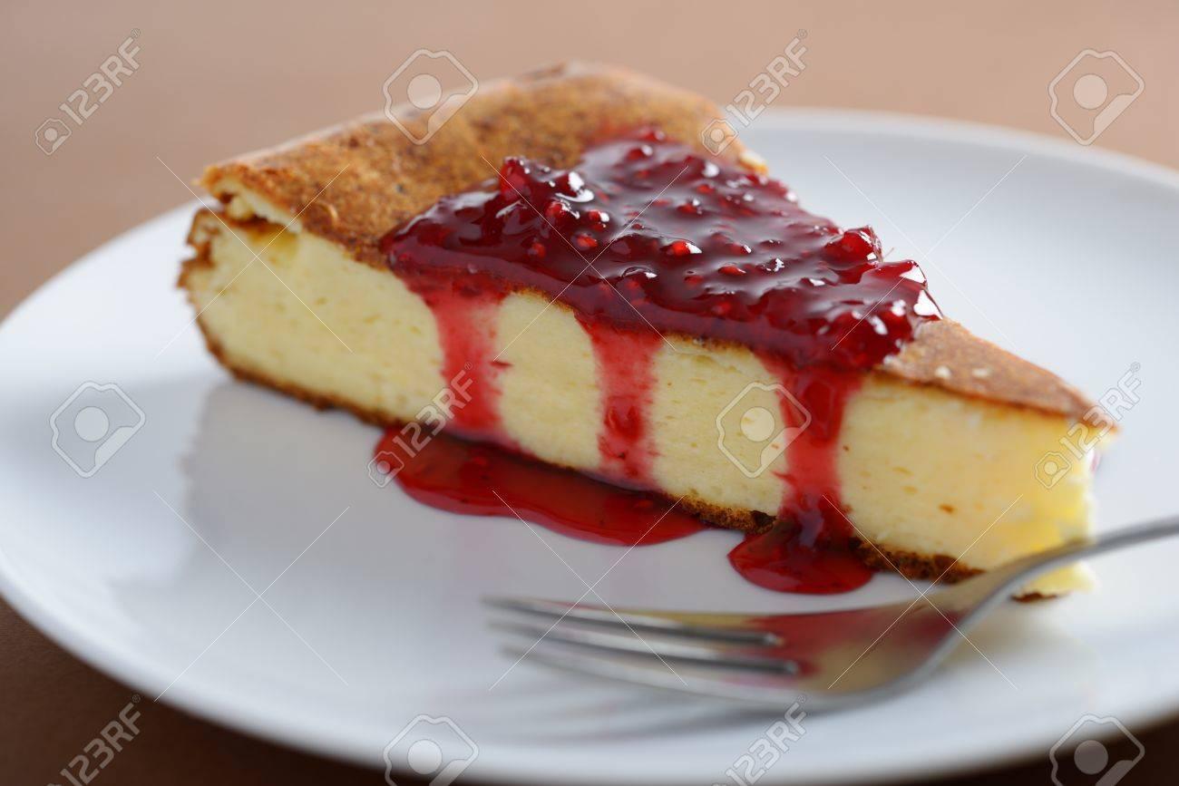 Slice of cheesecake with raspberry jam. Shallow DOF Stock Photo - 16476667