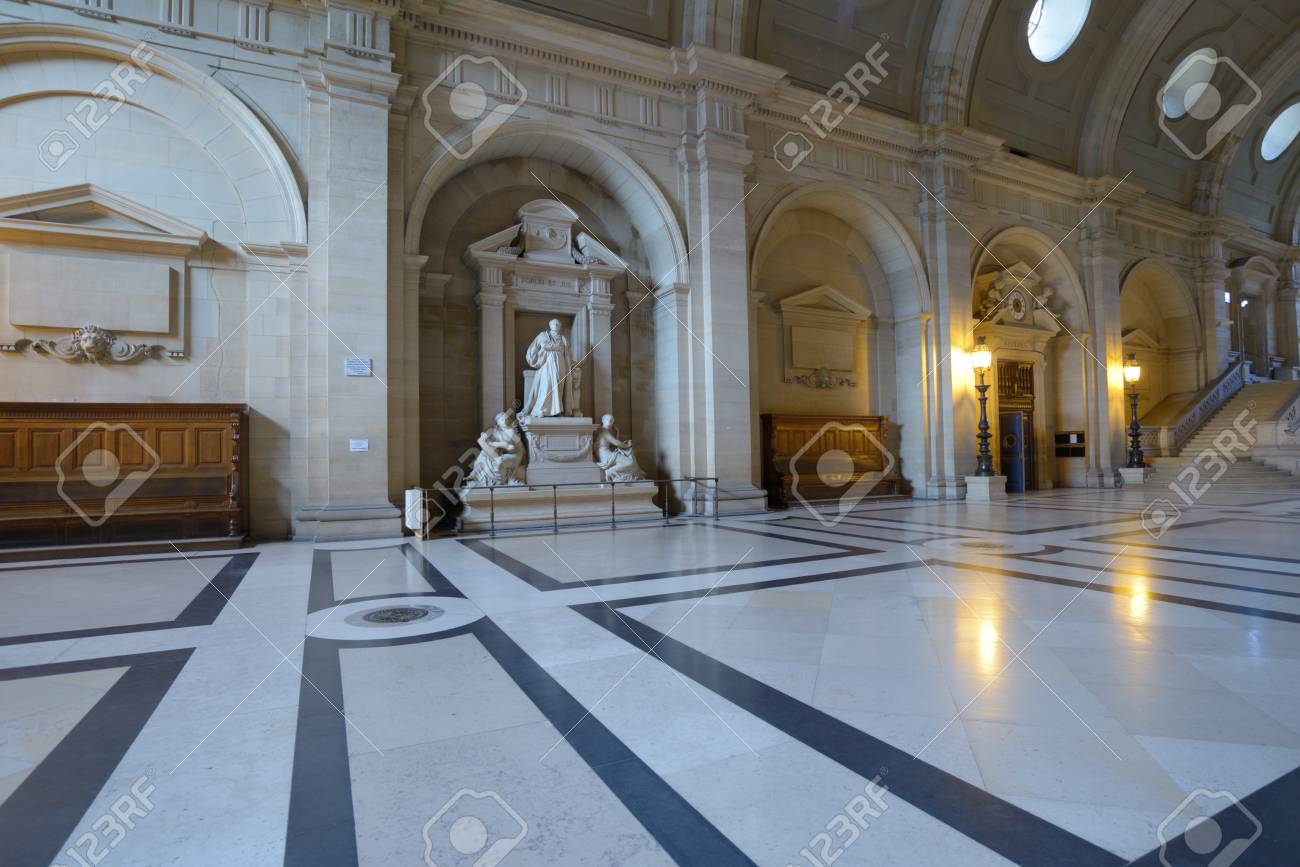 Paris, France - September 13, 2013: Interior of Palace of Justice with the statue of Pierre-Antoine Berryer. The statue designed by Chapu was erected in 1879 in memory of one of the greatest lawers of Palace - 31565862