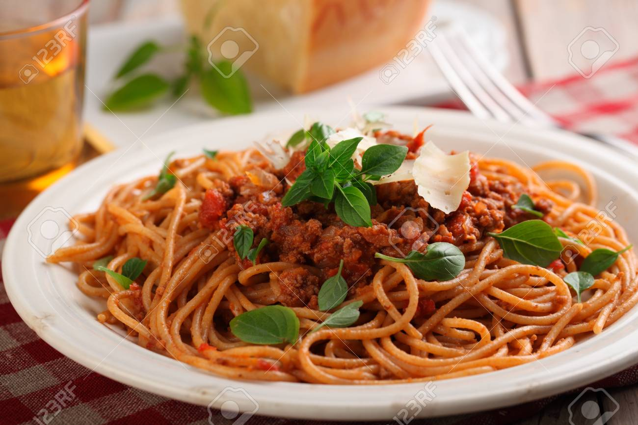 Spaghetti Alla Bolognese With Basil And Parmesan Cheese Stock Photo