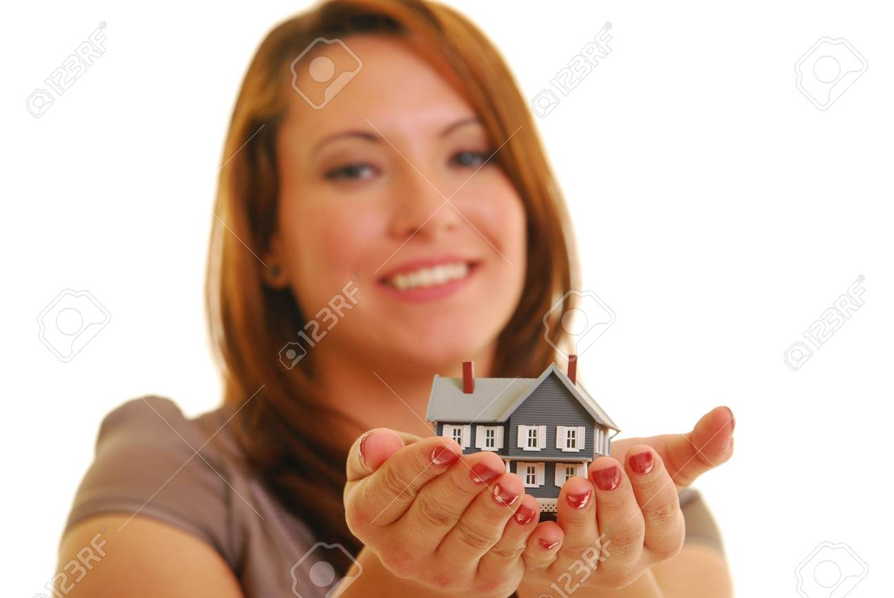 Smiling Caucasian woman holding miniature house. Shallow DOF. Focus on hands. Stock Photo - 5112643