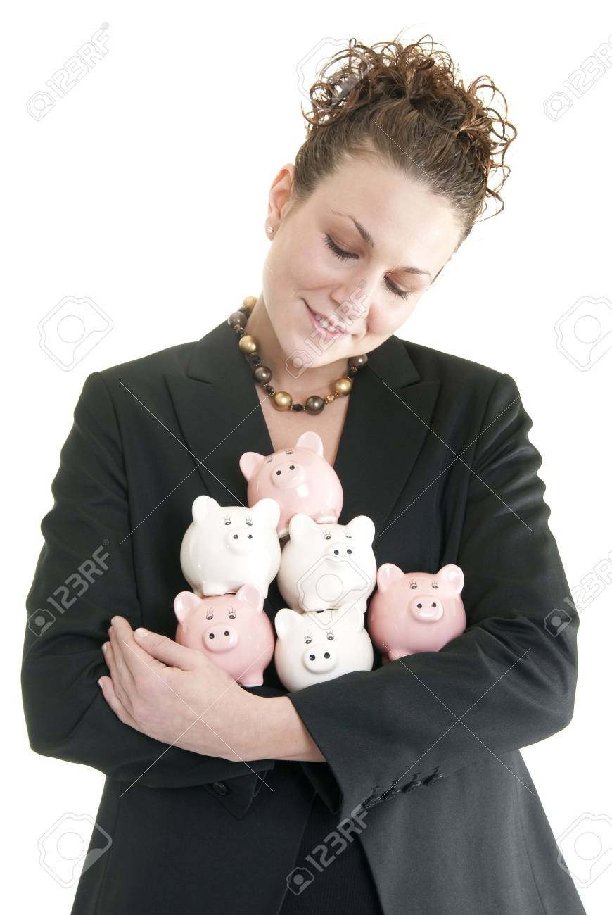 Attractive Caucasian business woman holding a pile of piggy banks isolated on white. Stock Photo - 6264074