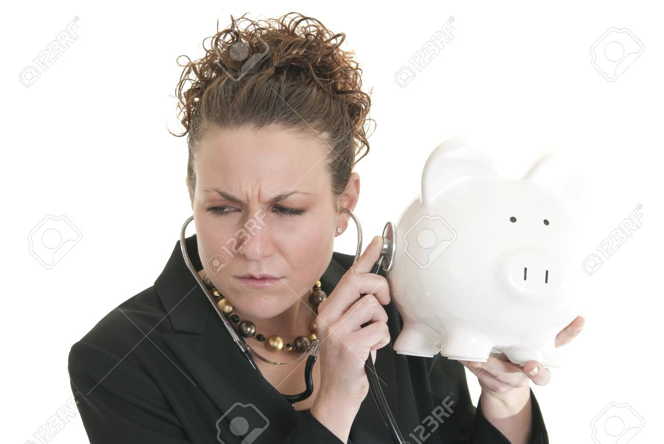 A beautiful Caucasian woman listens to a piggy bank with a stethoscope Stock Photo - 6384841