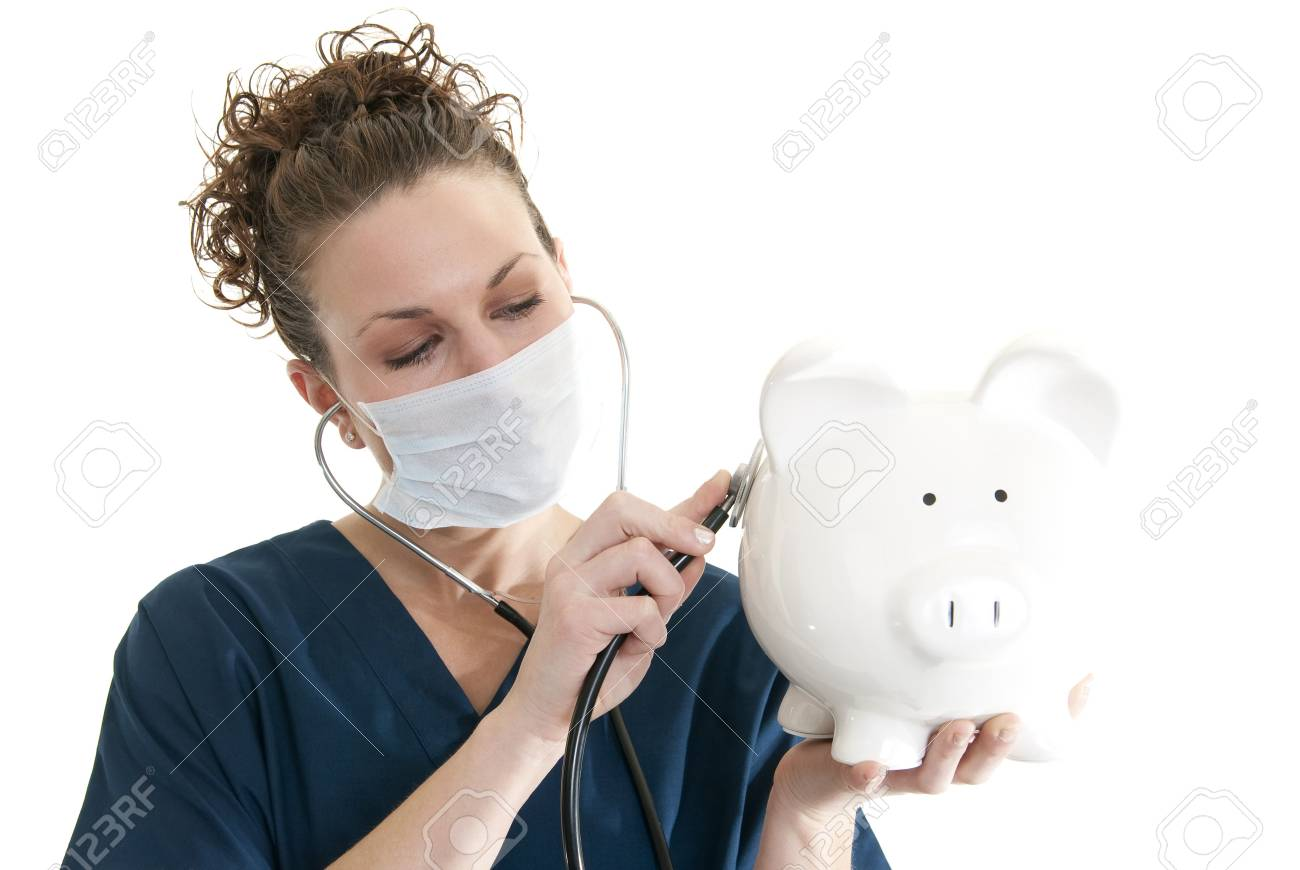 Beautiful, smiling Caucasian nurse listening to a piggy bank with a stethoscope Stock Photo - 6685669