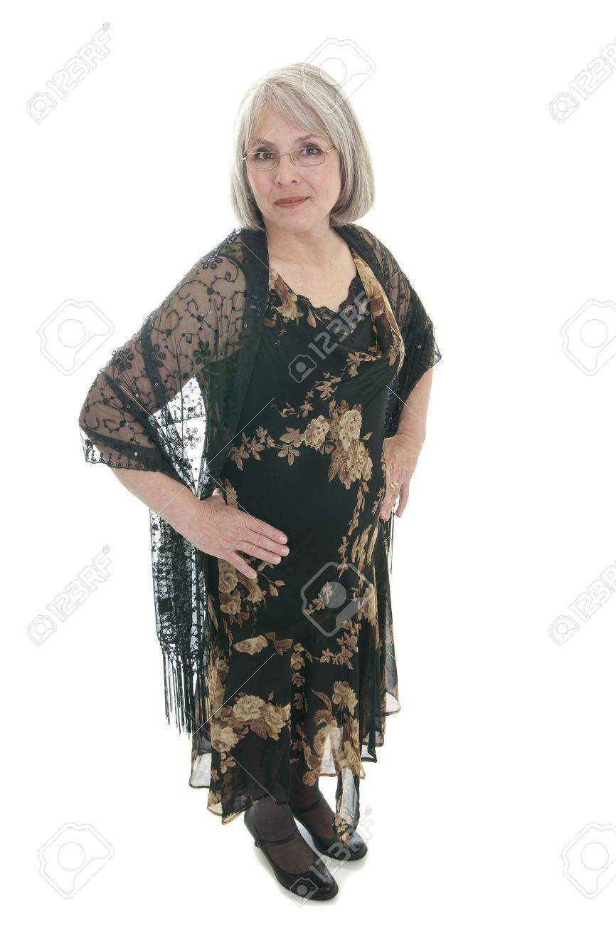4cd9279c1ea4 Mature, attractive Caucasian woman in a dress and shawl. Stock Photo -  7452255