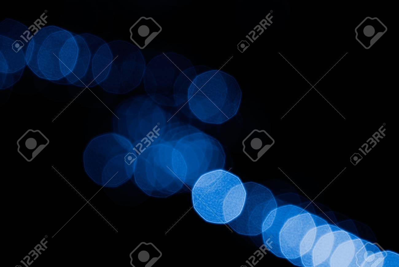 Beautiful blue blurred spot light arrange in a line. Stock Photo - 5950885
