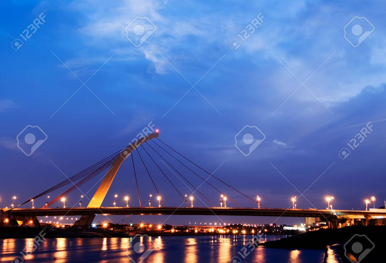 Dramatic cityscape of beautiful bridge over the river with lights reflection. Stock Photo - 5968196