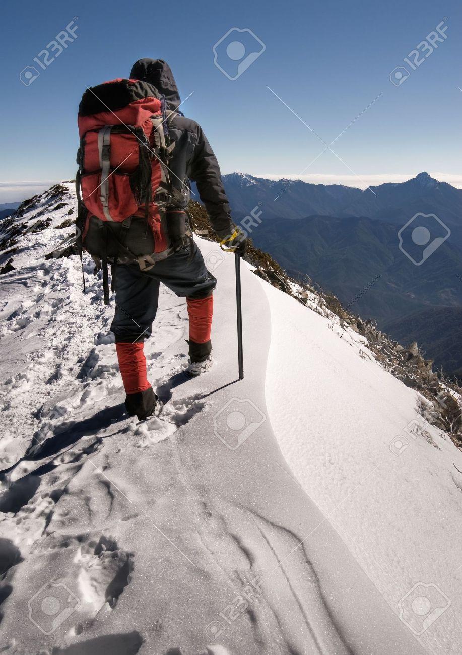 Single man of climber walk alone on top of snow ice winter mountain. Stock Photo - 6480625