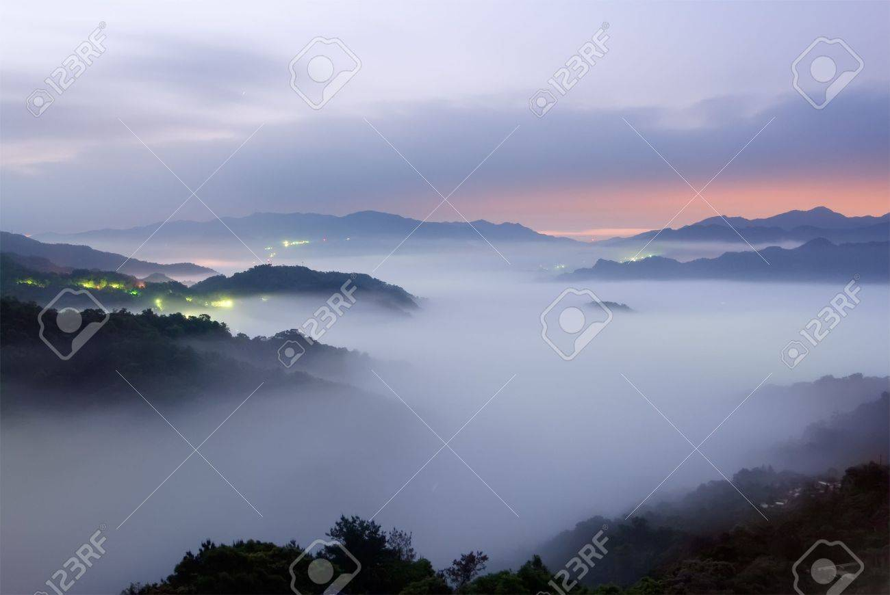 Landscape of mist scenery in hill of rural in dawn. Stock Photo - 6793594
