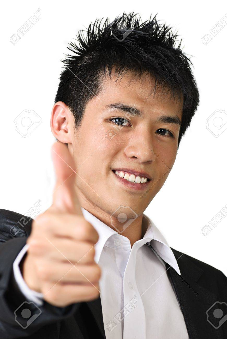 Happy young business man of Asian giving you a thumbs up sign isolated against white. Stock Photo - 7135379