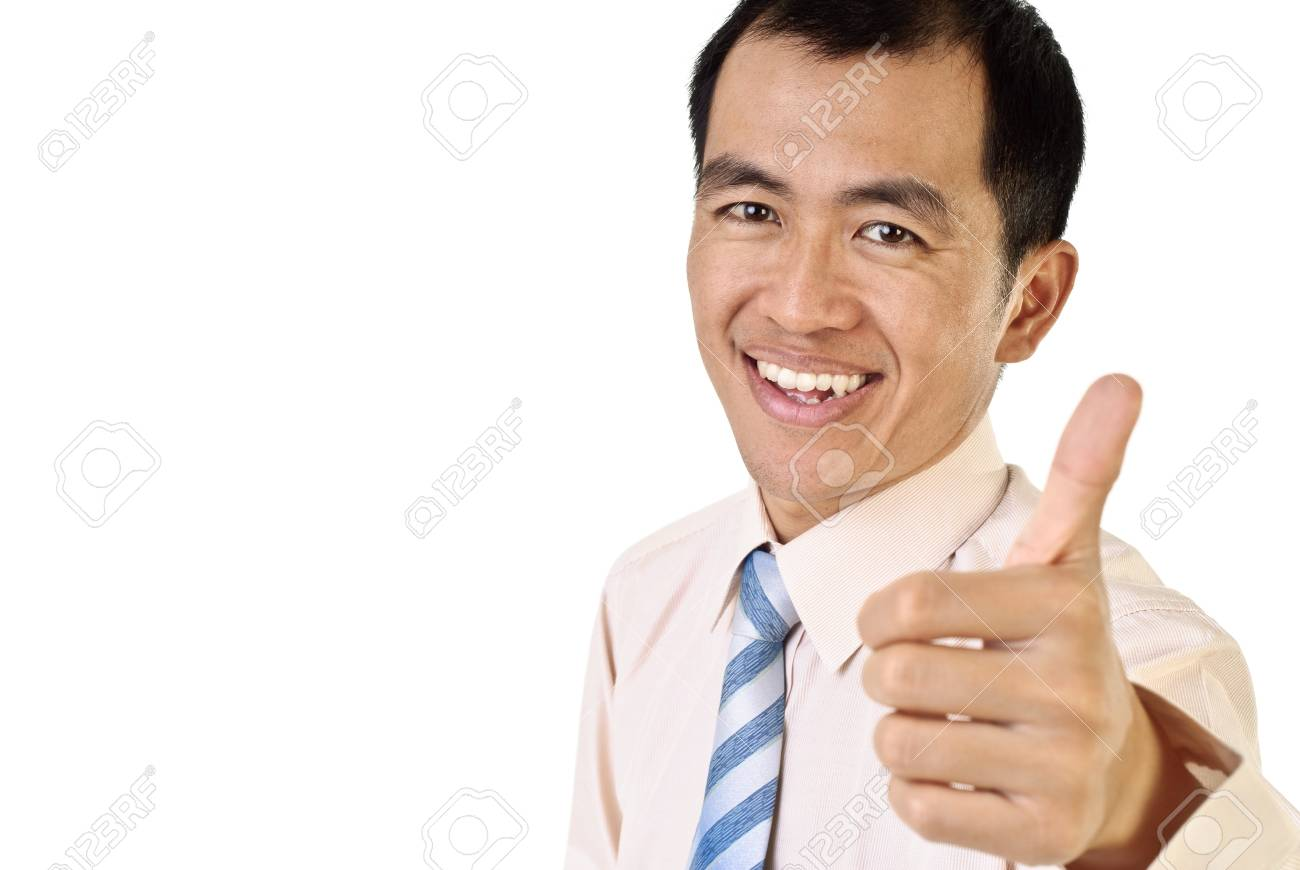 Portrait of smiling manager thumb up with copyspace on white. Stock Photo - 7304074