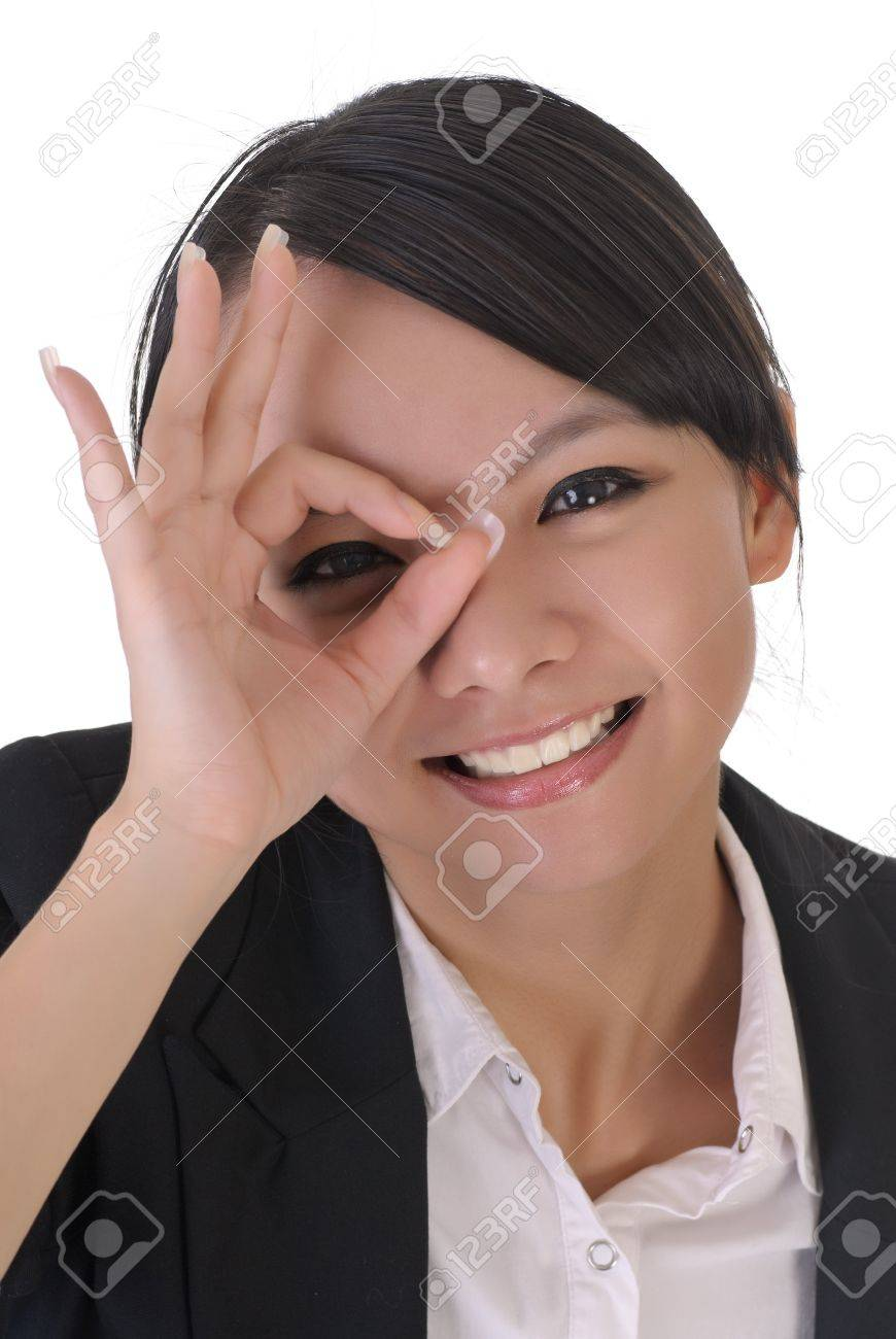 Cute office lady with funny face by put hands on one eye, closeup portrait on white background. Stock Photo - 7539144