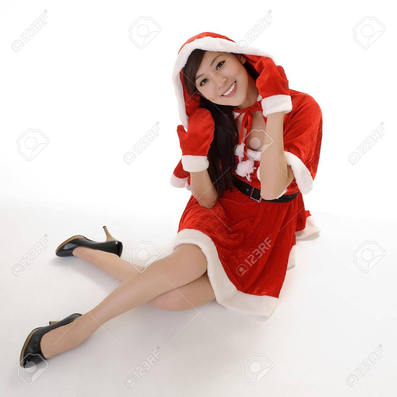 Attractive Christmas beauty sit on studio white ground with smiling expression. Stock Photo - 7943404