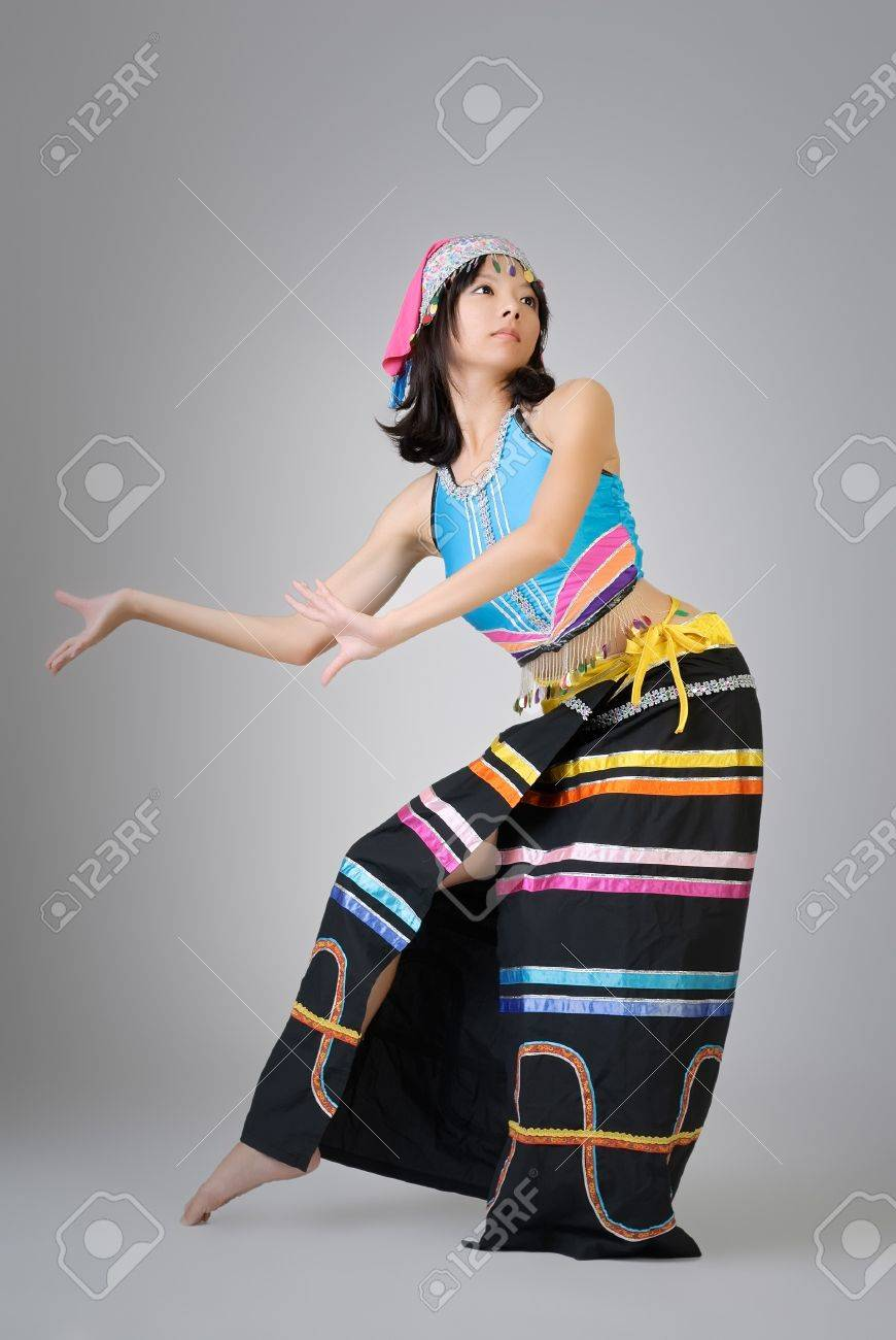 Attractive Chinese dancer in colorful traditional dress, Dai ethnic. Stock Photo - 7943445