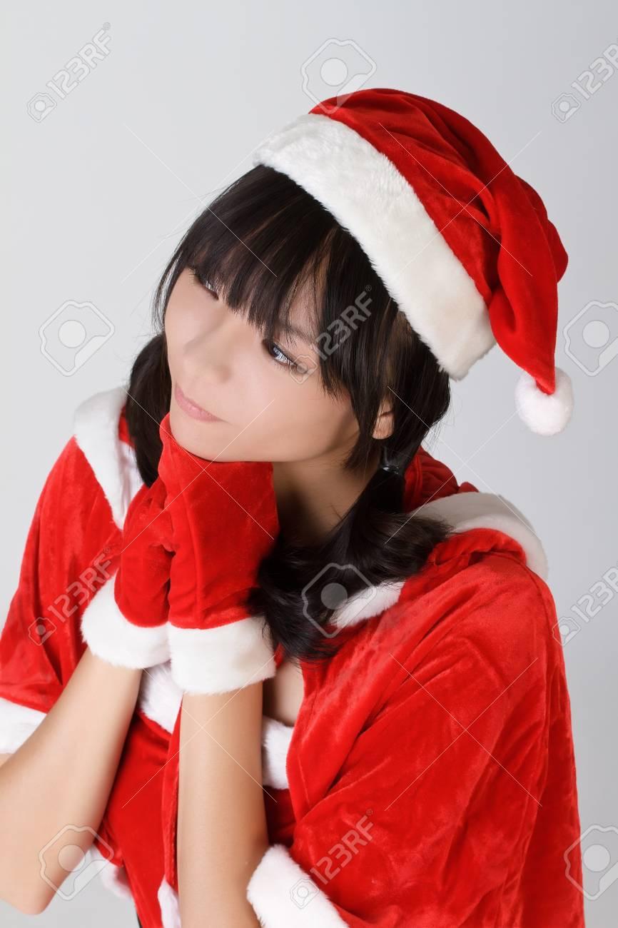 Christmas girl make a wish, closeup portrait over gray studio background. Stock Photo - 8068252