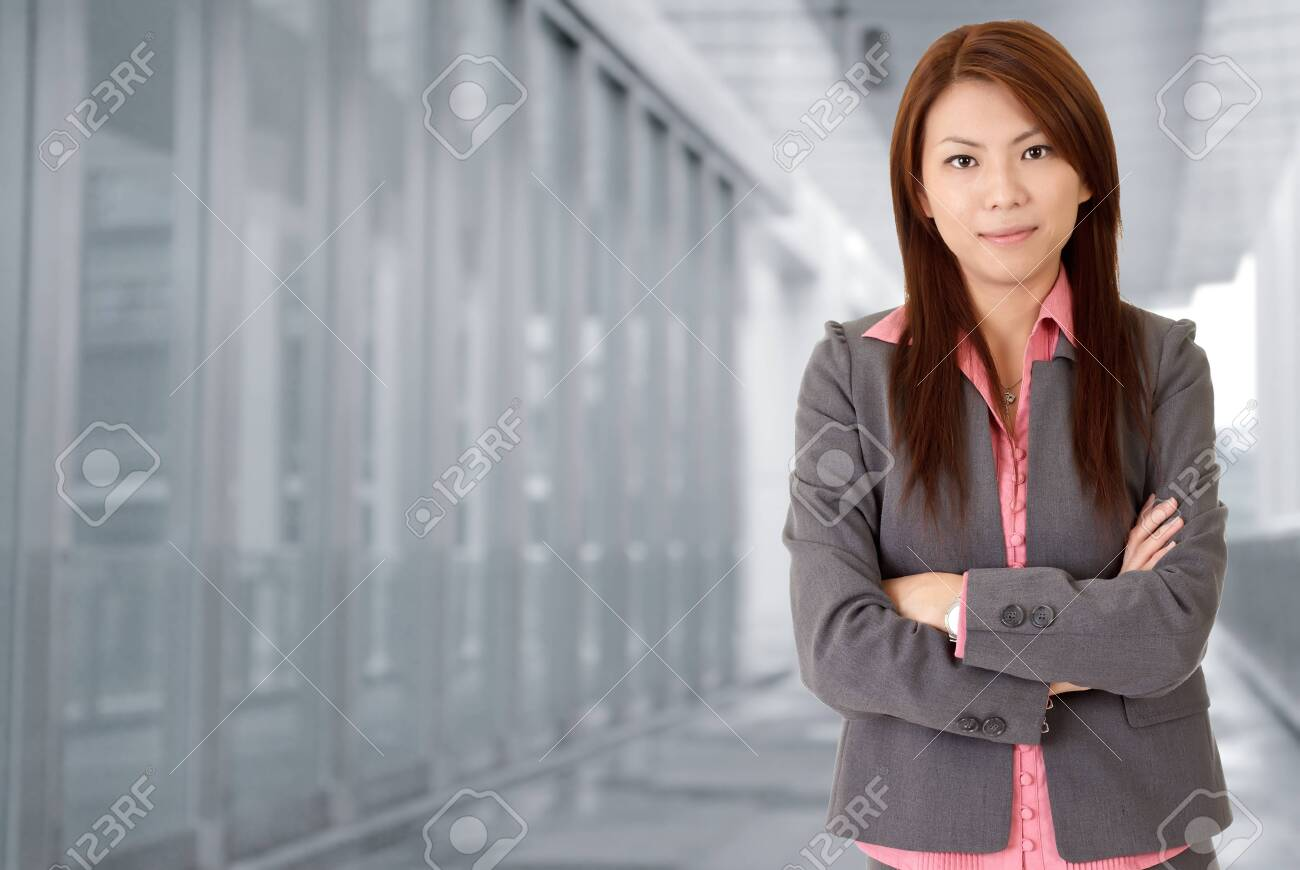 Young attractive business woman in corridor of modern building in outdoor. Stock Photo - 8285589