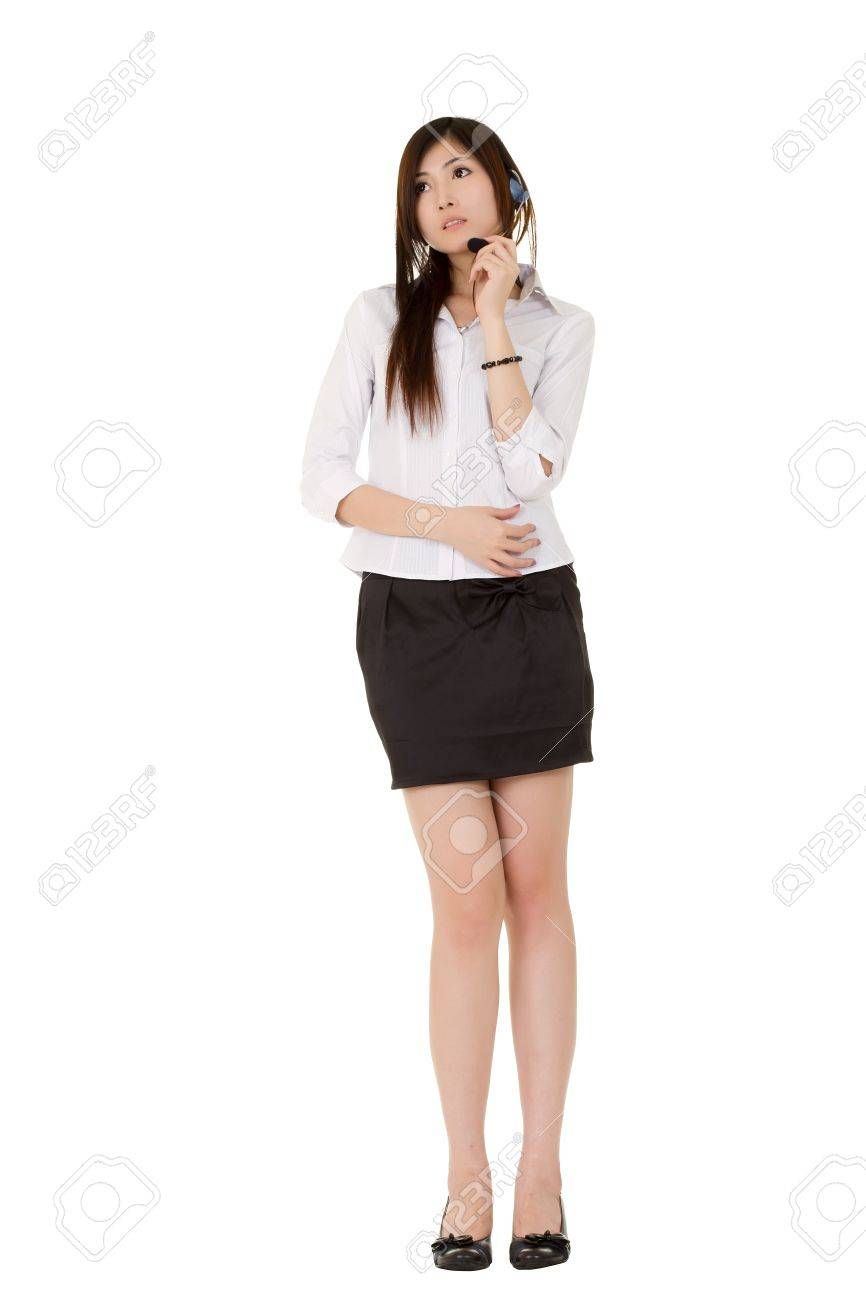 Attractive secretary with headphone standing over white background. Stock Photo - 8355314