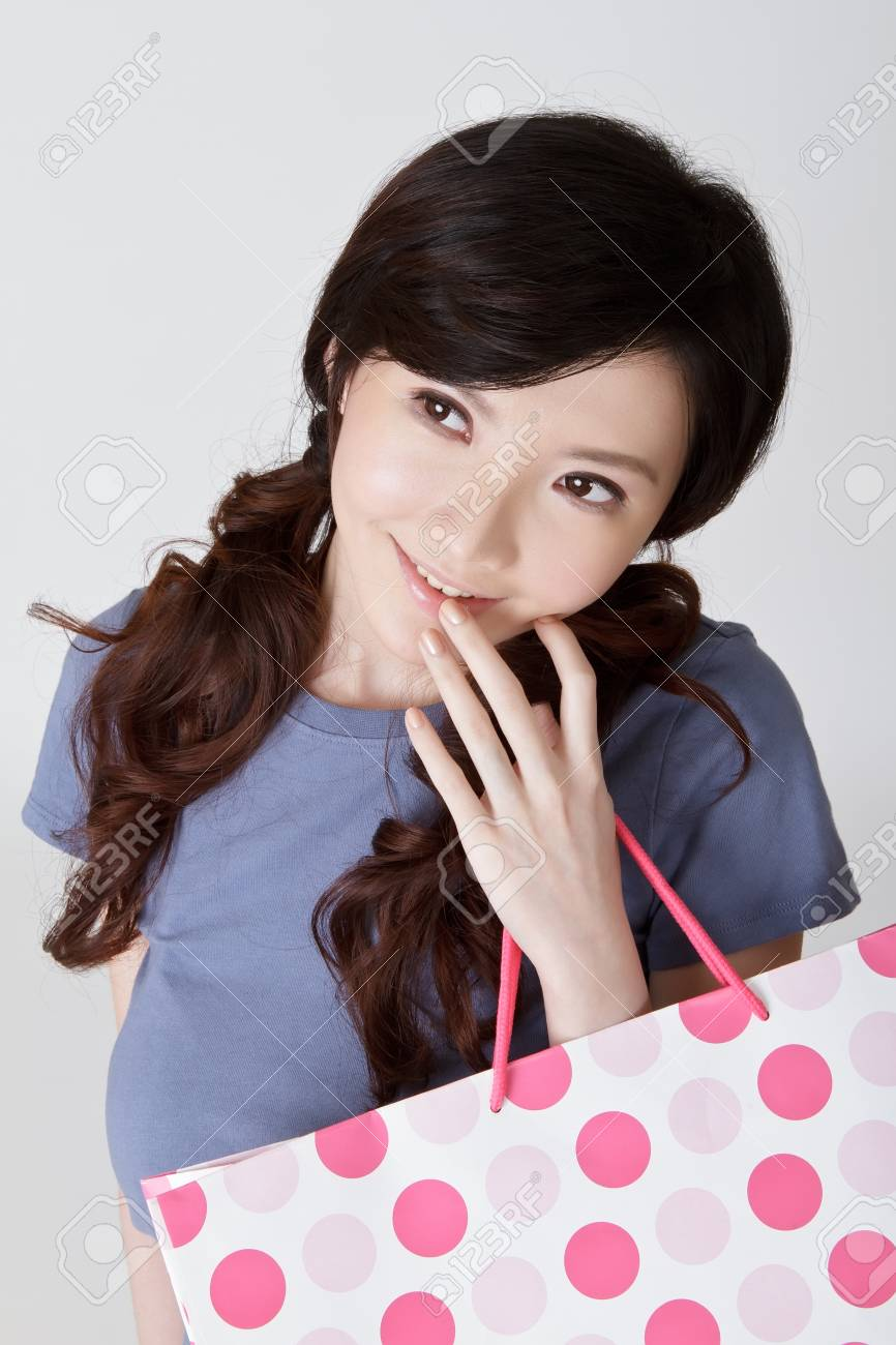 Adorable shopping woman thinking with attractive expression on face. Stock Photo - 9041886