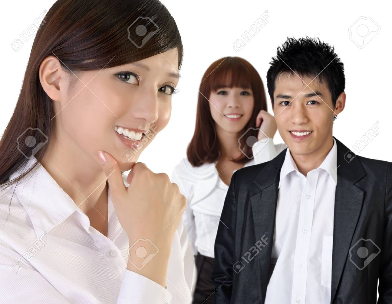 Successful Asian business woman with her team. Stock Photo - 9041992