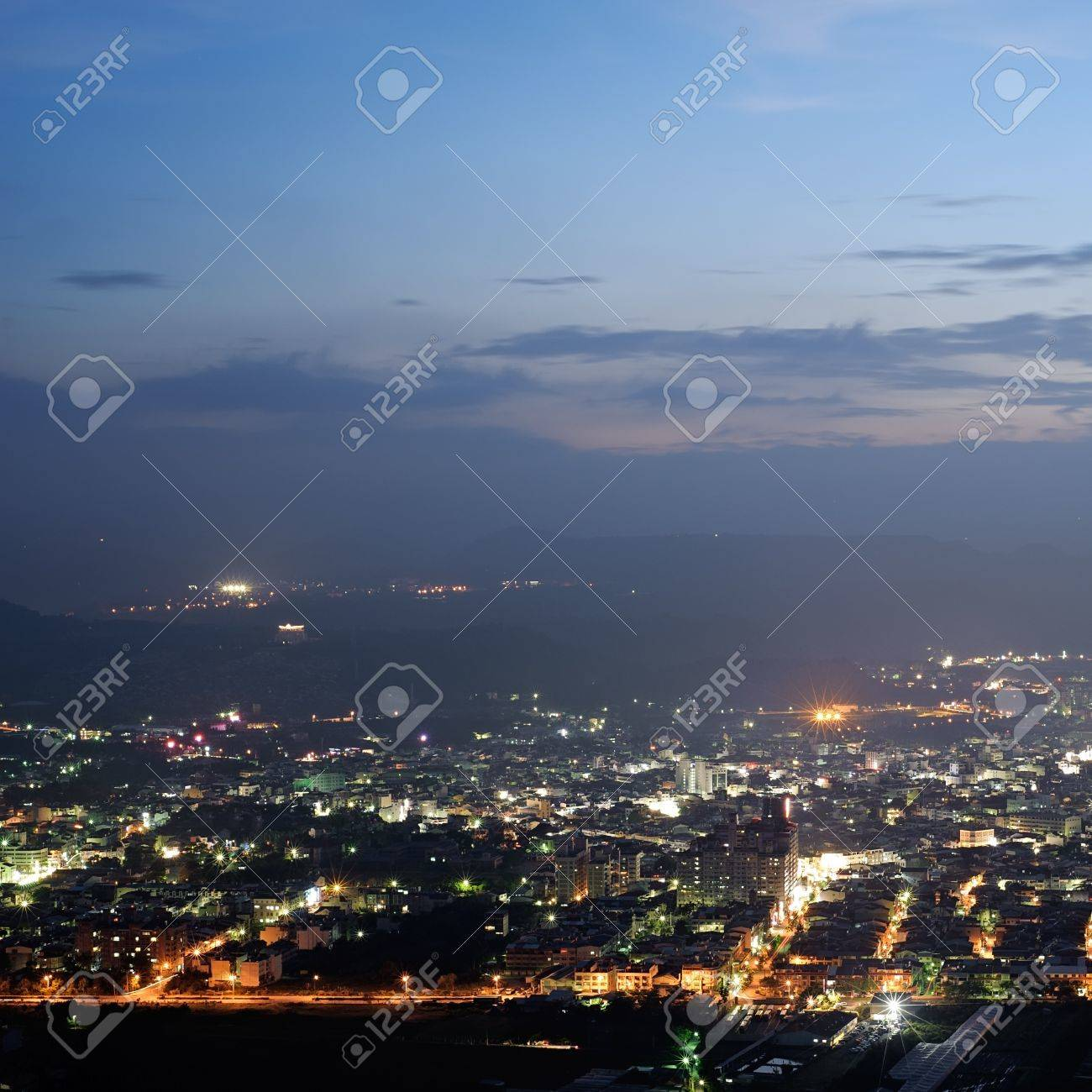 Cityscape of night scenery with houses and buildings under blue sky in Puli township, Nantou County, Taiwan, Asia. Stock Photo - 9647482