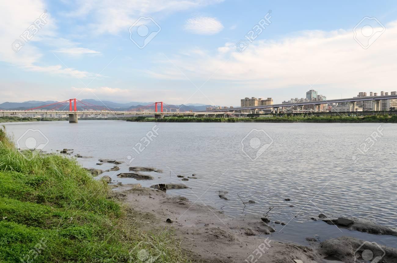 River in city under blue with bridge far away in Taipei, Taiwan, Asia. Stock Photo - 9789911