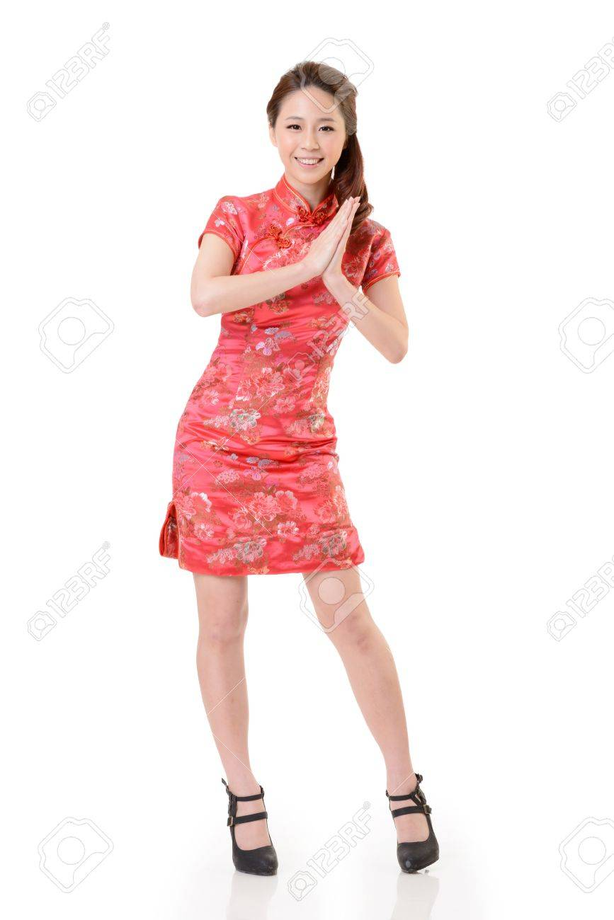 Smiling Chinese woman dress traditional cheongsam at New Year, studio shot isolated on white background. Stock Photo - 17481246