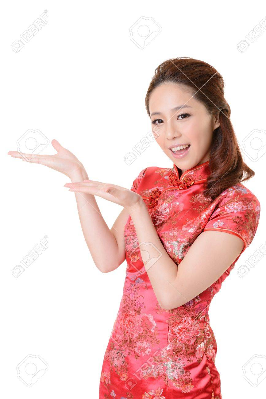 Smiling Chinese woman dress traditional cheongsam and introduce on white background. Stock Photo - 17481171