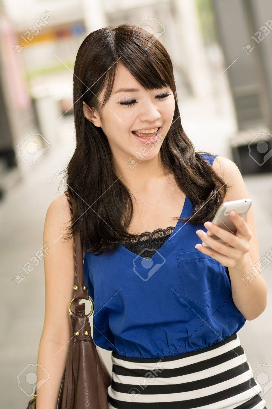 Asian Beauty With A Smile Looking At The Fence Outside stock photo ...