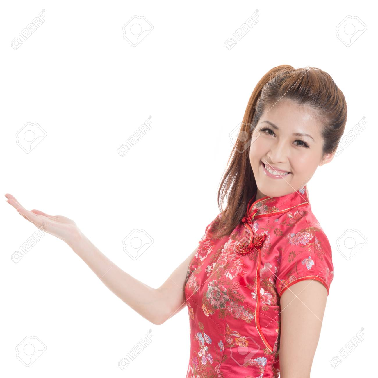 Smiling Chinese woman dress traditional cheongsam and introduce on white background. Stock Photo - 19634327