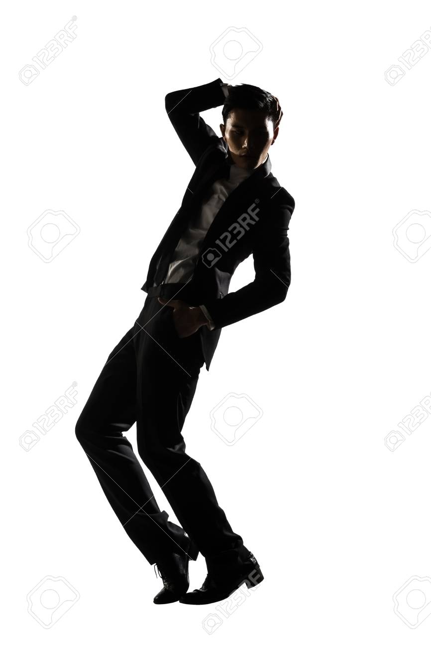 Silhouette Of Asian Businessman Dancing Or Posing Isolated On White Background Stock Photo